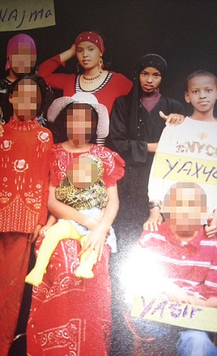 Home: This is a picture of Yahya Abdi, (top right) then aged 10 in November 2008 in the Boli District of Ethiopia