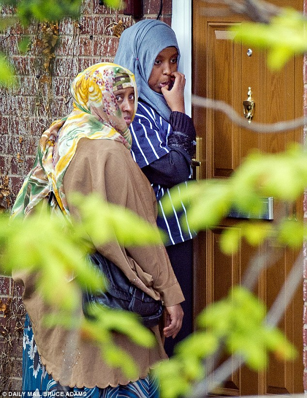 Support: Visitors arrive at the family home yesterday