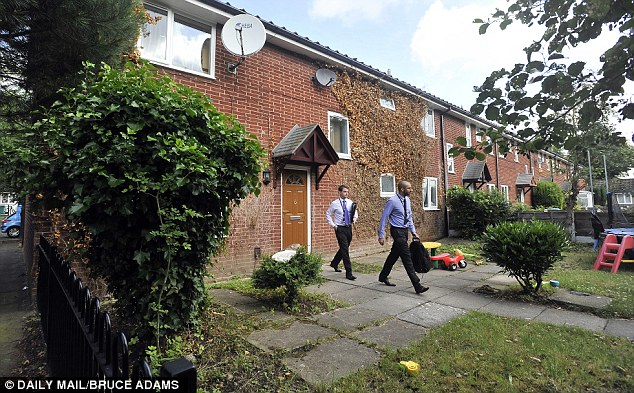 Police probe: Officers were seen leaving the house. The large back and front gardens were strewn with discarded household items and children's plastic toys