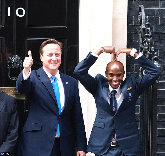 Prime Minister David Cameron poses with Farah outside No 10 Downing Street after his 5,000m Olympic win