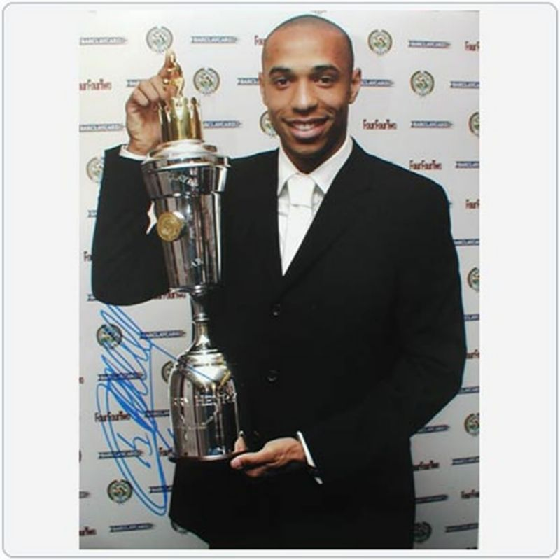 THIERRY_HENRY_Holding_Trophy.jpg