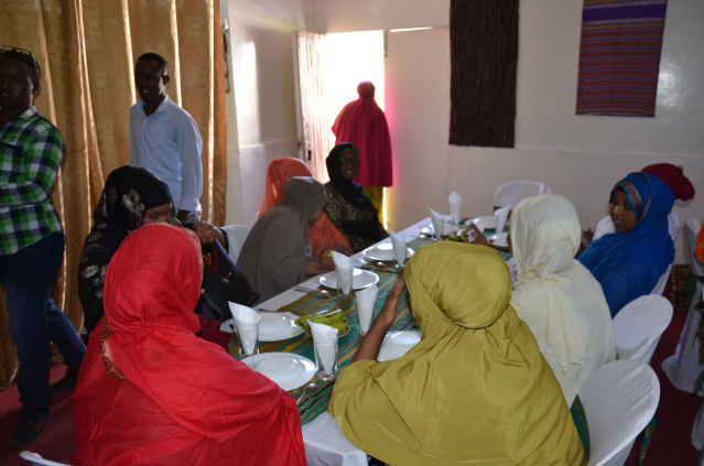 At the table with friendly Somali ladies waiting for the meal
