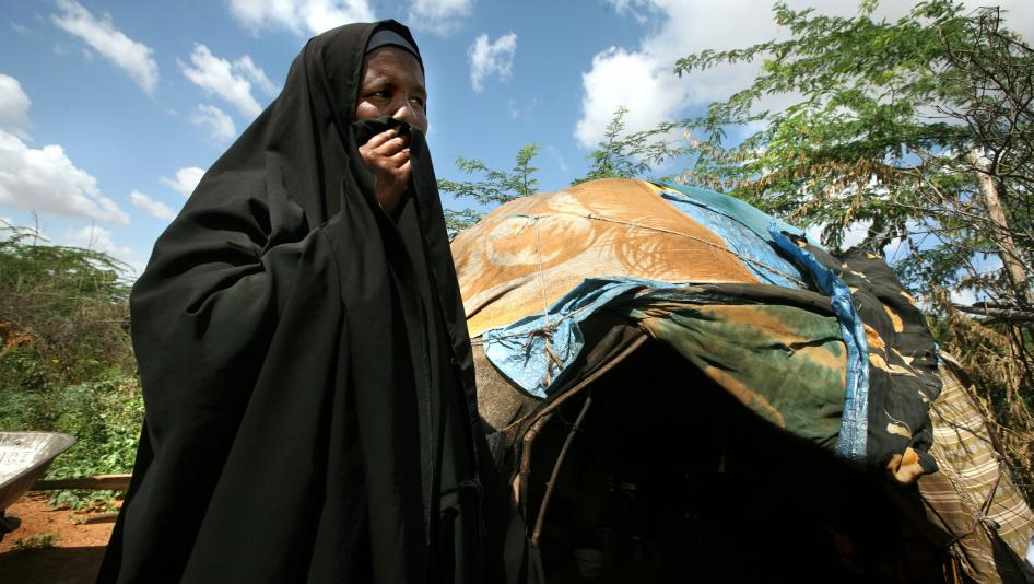 A refugee woman from Imey, a town in the Gode zone of Ethiopia's Somali Region, stands outside her makeshift home in Dadaab refugee camp in northern Kenya. She and her children fled to Kenya after her husband was killed by Ethiopian forces in December 200