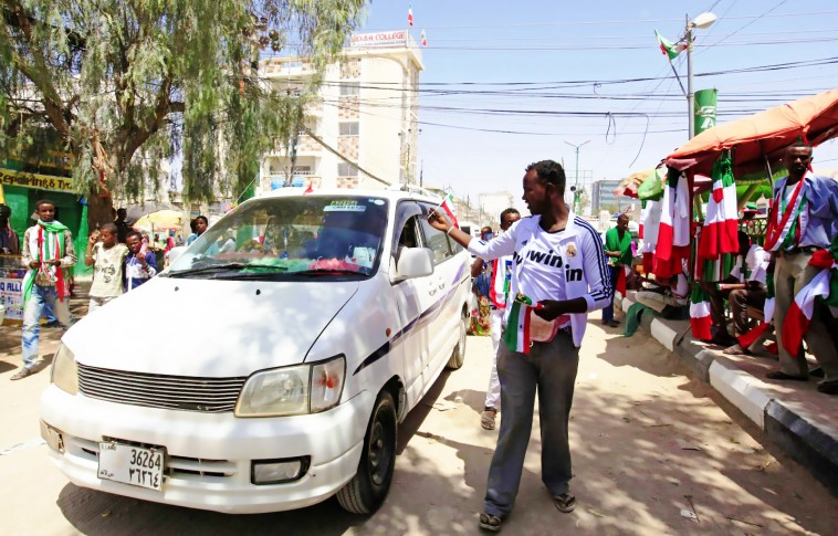 a-somaliland-resident-in-hargeisa-sells-a-flag-on-the-anniversary-of-independence-day-of-somaliland